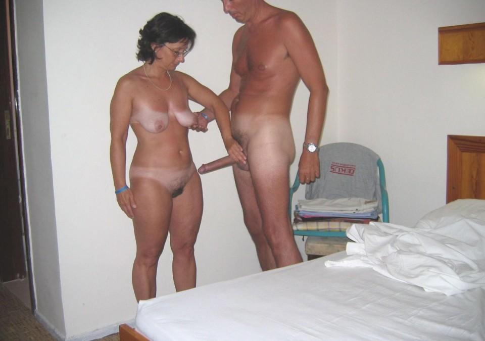 Nude men posing in bed