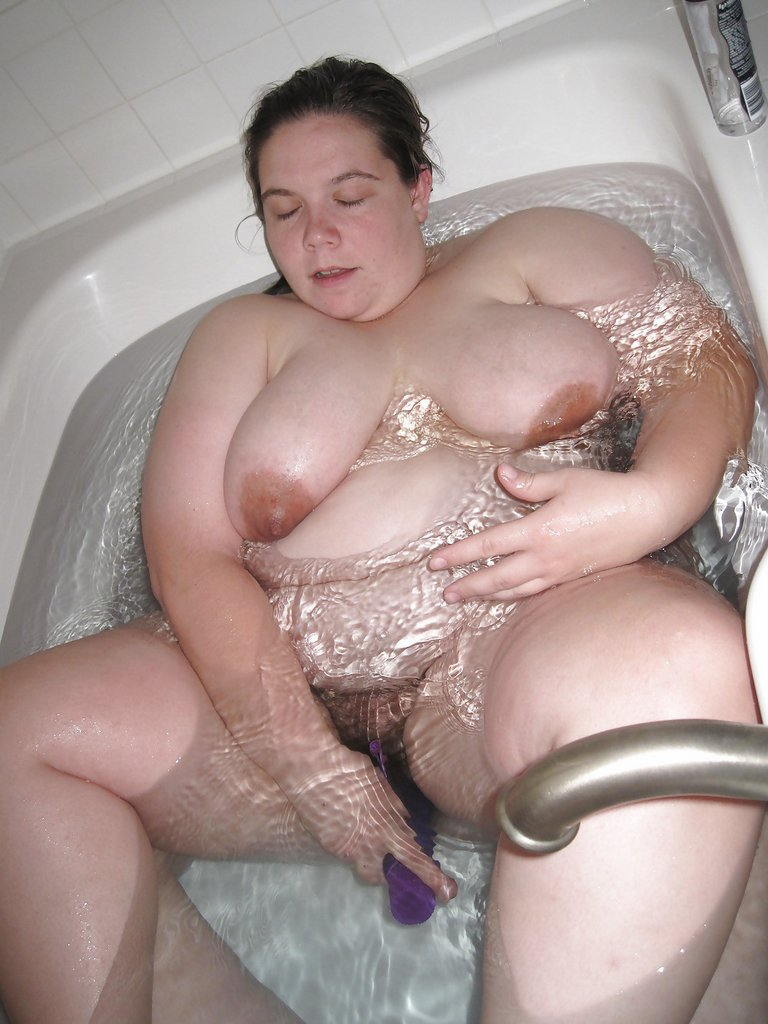 Woman Inserting Large Dildos